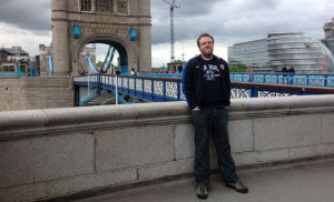Eric Say poses near the Tower Bridge over the Thames River in London during the Summer Olympics, where the 2009 SDSU graduate worked for NBC Universal.