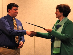 Marcus Traxler, junior news-editorial major and the new Collegian editor, received two scholarships.