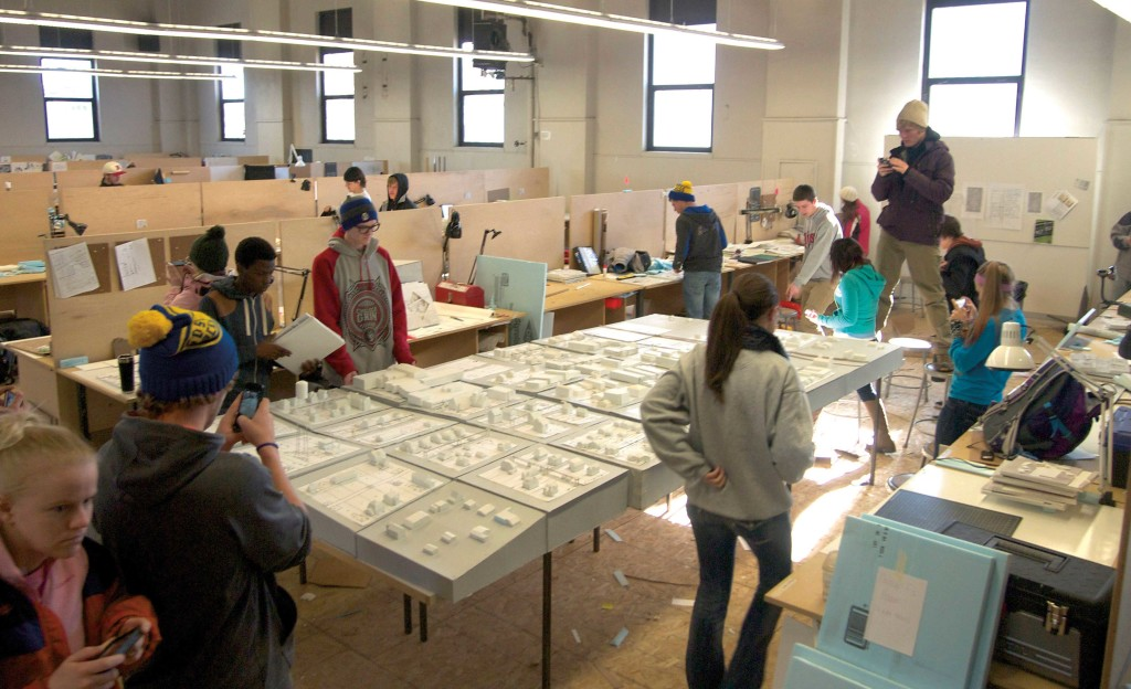 Department of architecture students view their model of Webster. Students created the model as part of an attempt to revitalize the town in northeastern South Dakota. The program is in its fourth year.