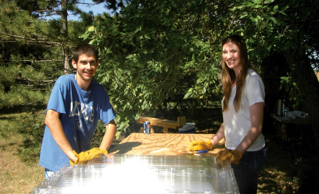 For a service-learning project in their French class, Jaimie Gibbons & Jory Marinan spend an afternoon at the Haiti Solar Oven Partners workshop in Volga where they pre-assemble solar ovens that will be shipped in a sea container to Haiti.
