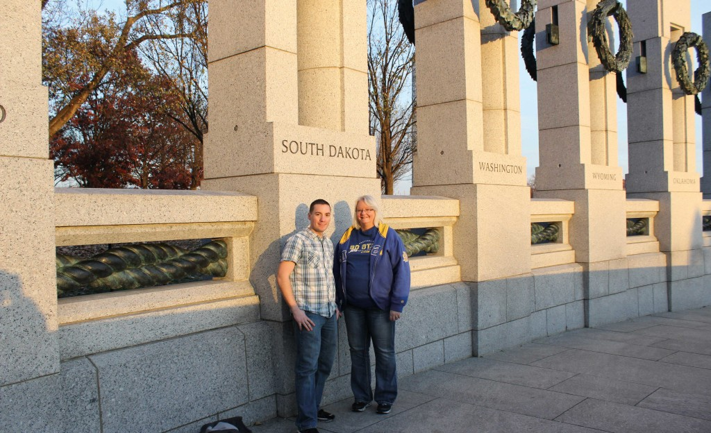 Don Richards and Pat Tille stand next to the South Dakota pillar at the National World War IIMemorial when they were in Washington, D.C.