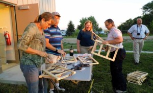 Teachers from Sisseton, Selby Area, Tripp-Delmont and Newell gather at the school in Faith to build plant presses.