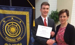 Joe Schartz received the Carol Peterson Leadership Scholarship from the South Dakota State University Honorary Society of Phi Kappa Phi during its recent initiation session. Schartz received a certificate from Kay Cutler, the chapter's past president.