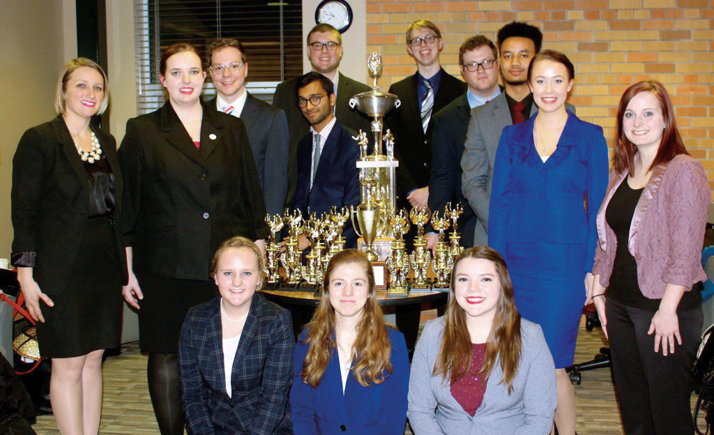 SDSU won the 2016 South Dakota Intercollegiate Forensics Association State Championships held February in Aberdeen. Viraj Patel is in the middle row, to the left of the largest trophy. Lauren Buisker is the first person in the front row.